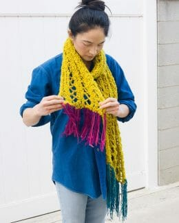 Canary Colorblock Fringe Scarf worn on female standing straight