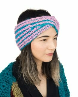 pink and blue knit headband on model